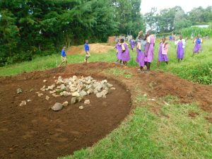 The Water Project:  Pupils Help Deliver Stones For Rain Tank Foundation