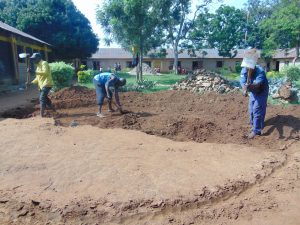 The Water Project:  Excavating Rain Tank Site