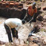 The Water Project: Masuveni Community, Masuveni Spring -  Taking Measurements