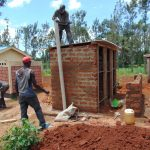 The Water Project: Demesi Primary School -  Fitting The Ventilation Pipe