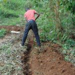 The Water Project: Bumira Community, Madegwa Spring -  Leveling The Area