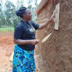 The Water Project: Demesi Primary School -  Field Officer Karen Trying Out Her Masonry Skills On Latrine Walls