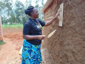 The Water Project:  Field Officer Karen Trying Out Her Masonry Skills On Latrine Walls