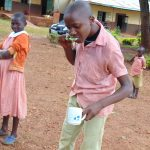 The Water Project: Kakamega Muslim Primary School -  A Student Demonstrates Toothbrushing