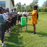 The Water Project: Ebulonga Mixed Secondary School -  Trainer Lillian Achieng Leads Handwashing Session