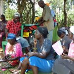 The Water Project: Masuveni Community, Masuveni Spring -  Participants Listen And Take Notes