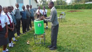 The Water Project:  Students Demonstrates Handwashing