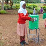 The Water Project: Kakamega Muslim Primary School -  A Student Demonstrates Handwashing