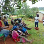 The Water Project: Masuveni Community, Masuveni Spring -  Handwashing Session Led By Trainer Laura Alulu
