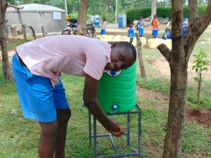 The Water Project:  Student Clintone Uses A Handwashing Station
