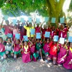 The Water Project: Nanganda Primary School -  Students Hold Training Materials After Completing The Day