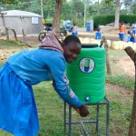 The Water Project: Banja Primary School -  Student Videlis Washes Her Hands