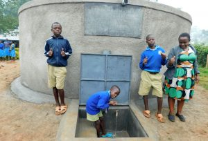 The Water Project:  Students And Teacher With Rain Tank