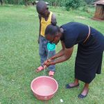 The Water Project: Munenga Community, Francis Were Spring -  Joan Demonstrates Handwashing