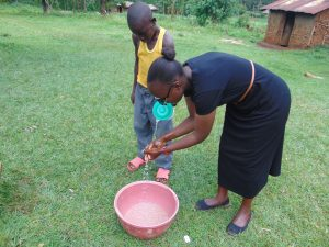 The Water Project:  Joan Demonstrates Handwashing