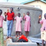 The Water Project: Kakamega Muslim Primary School -  Students Wave From The New Rain Tank