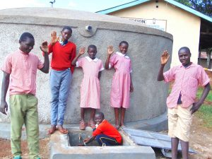 The Water Project:  Students Wave From The New Rain Tank