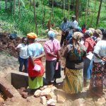 The Water Project: Masuveni Community, Masuveni Spring -  Trainer Laura Alulu Leads On Site Training