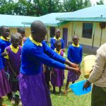 The Water Project: Kapkures Primary School -  Student Demonstrates Handwashing