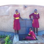 The Water Project: Nanganda Primary School -  Girls Pose With The Rain Tank