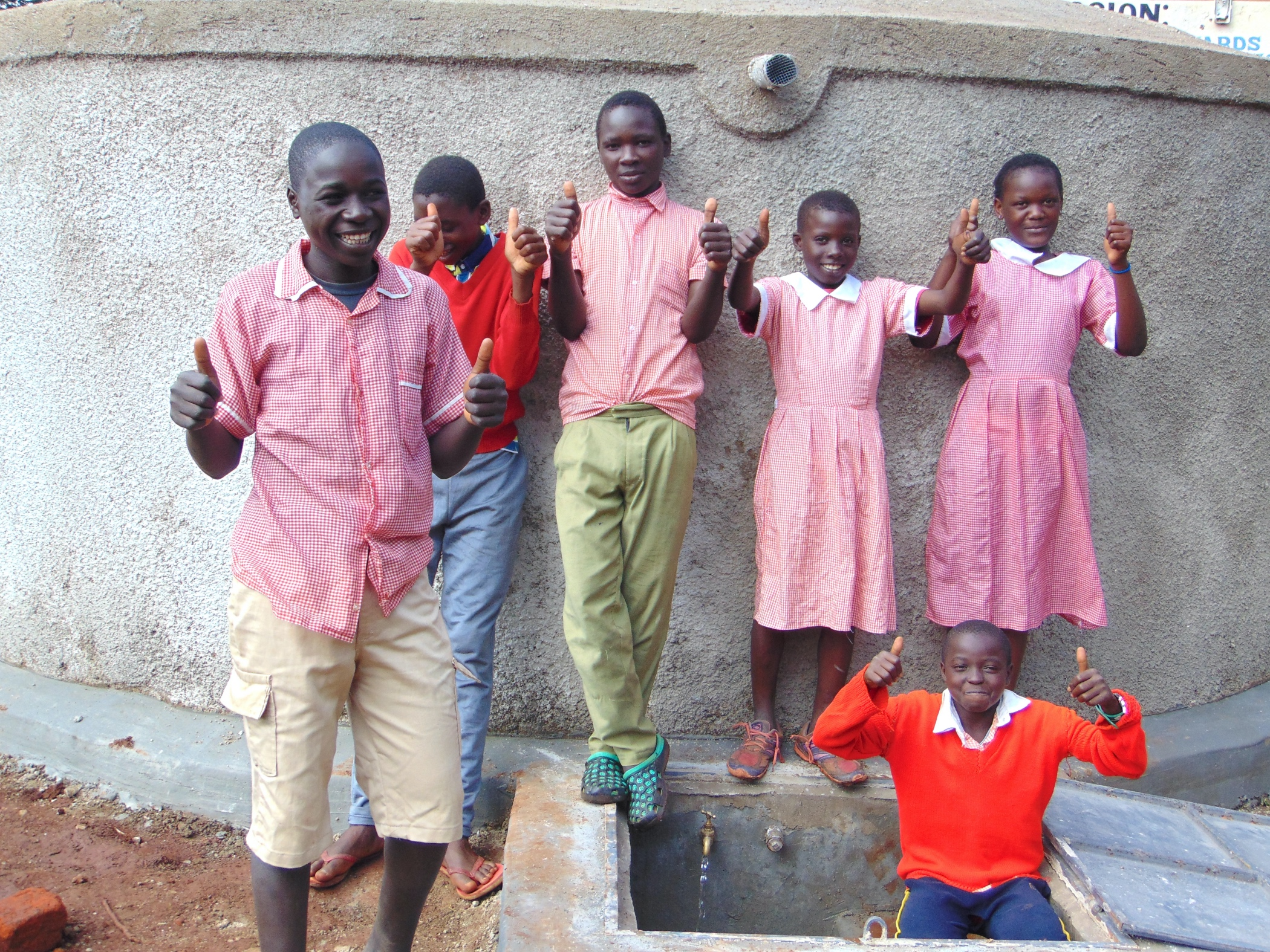 The Water Project : 29-kenya19083-thumbs-up-and-smiles-for-clean-water