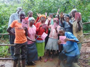 The Water Project:  Showing Off Booklets After Completing Training