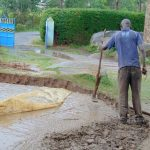 The Water Project: Banja Primary School -  Adding Concrete To Foundation