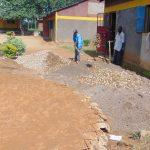 The Water Project: Nanganda Primary School -  Preparing Concrete Next To Rain Tank Foundation
