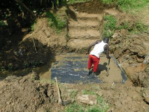 The Water Project:  Adding Concrete To Foundation