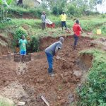 The Water Project: Munenga Community, Francis Were Spring -  Community Helps Excavate Further After Early Brickwork