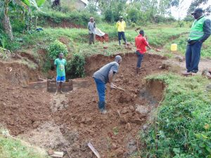 The Water Project:  Community Helps Excavate Further After Early Brickwork