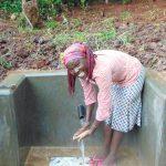 The Water Project: Masuveni Community, Masuveni Spring -  Enjoying Clean Water