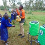 The Water Project: Demesi Primary School -  Leaky Tin Handwashing Demnstration