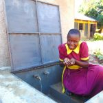 The Water Project: Nanganda Primary School -  Fresh Water In Hand