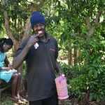 The Water Project: Emulembo Community, Gideon Spring -  Volunteer Demonstrates Proper Toothbrushing During Dental Session