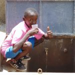 The Water Project: Banja Primary School -  Enjoying A Fresh Drink