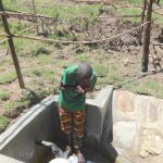The Water Project: Sambaka Community, Sambaka Spring -  Taking A Fresh Drink