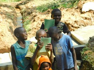 The Water Project:  Kids Pose With Training Materials At The Spring