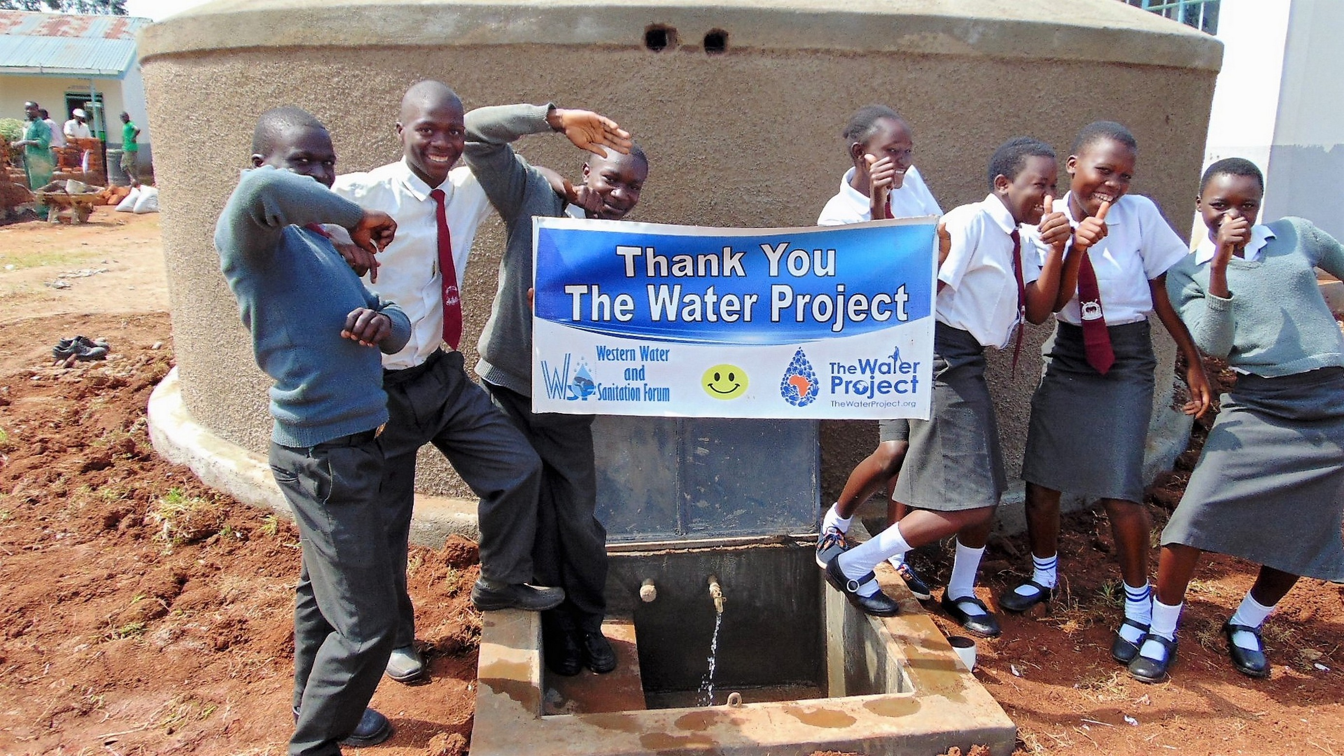 The Water Project : 33-kenya19051-students-celebrate-the-rain-tank