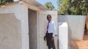 The Water Project:  A Girl Poses With The New Latrines