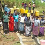 The Water Project: Sambaka Community, Sambaka Spring -  Women With Clean Water Ready To Head Home