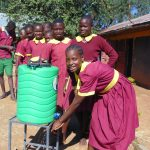 The Water Project: Nanganda Primary School -  Students Line Up To Wash Hands