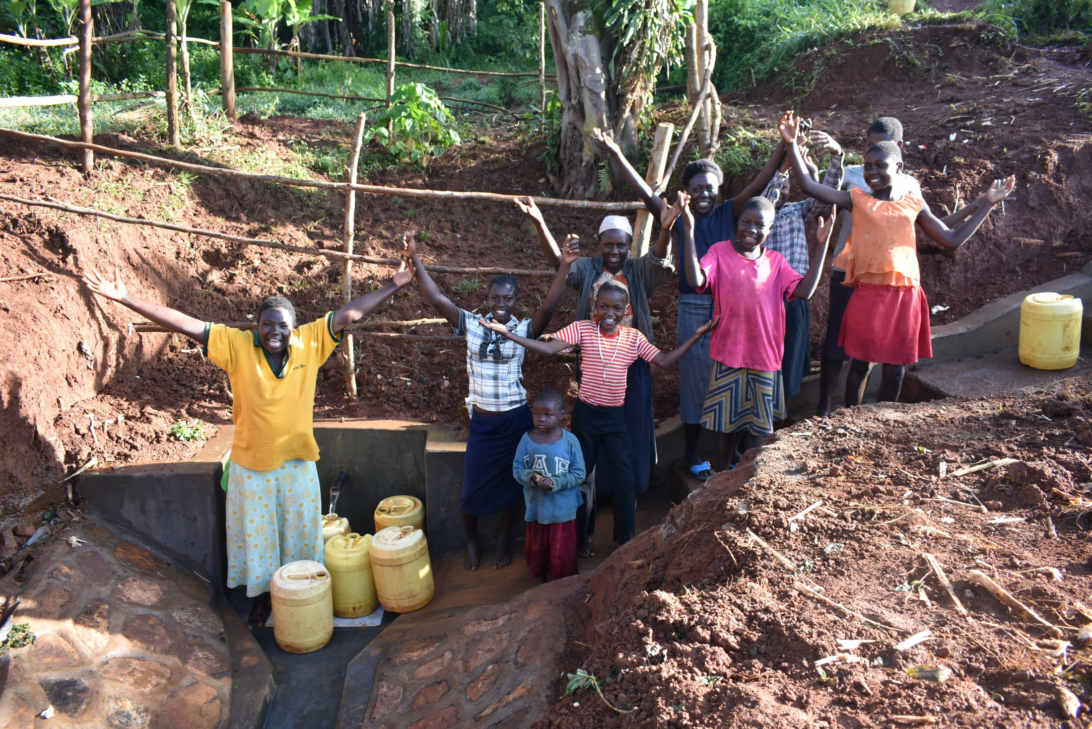 The Water Project : 35-kenya19180-community-members-celebrate-finished-spring-1