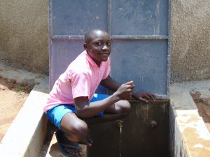 The Water Project:  Smiles At The Rain Tank