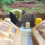 The Water Project: Munenga Community, Francis Were Spring -  Enjoying Clean Water