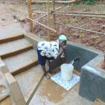 The Water Project: Bumira Community, Madegwa Spring -  Thumbs Up For Clean Flowing Water