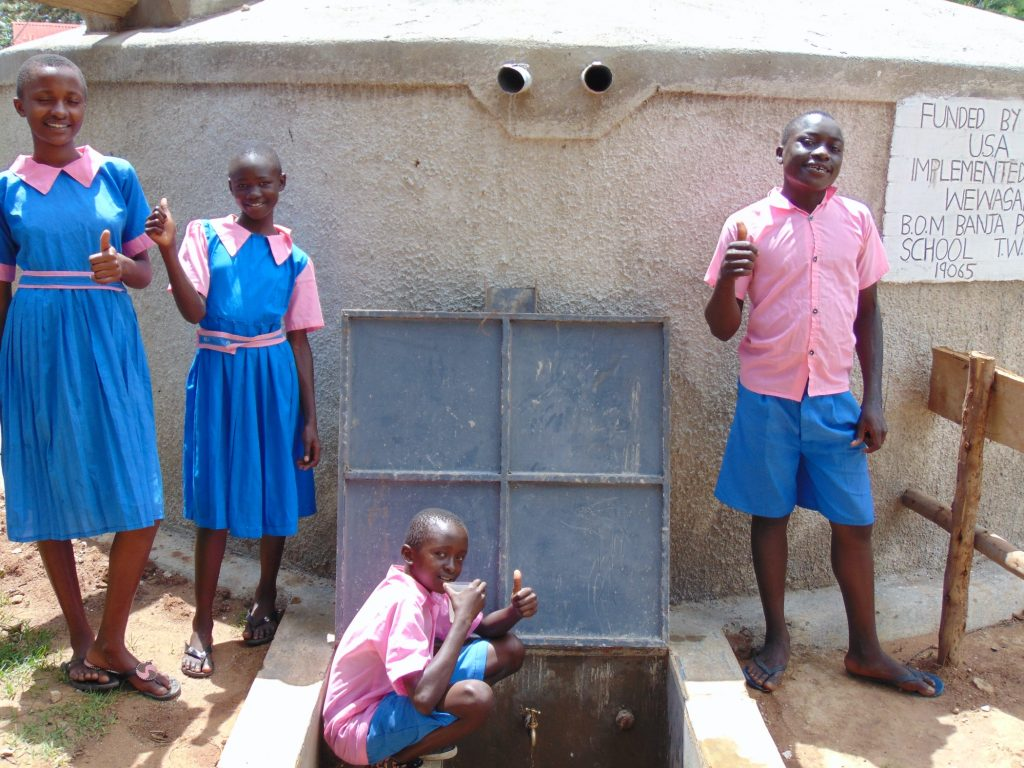 The Water Project : 38-kenya19065-students-pose-with-the-rain-tank