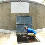 The Water Project: Kapkures Primary School -  Enjoying Rain Tank Water