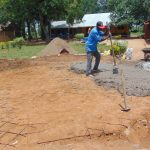 The Water Project: Nanganda Primary School -  Adding Concrete To Foundation
