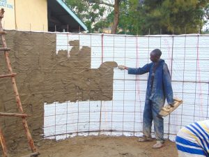 The Water Project:  Cementing Inside The Tank